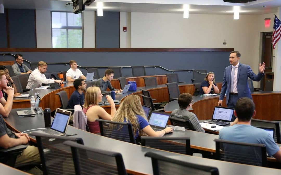 Professor Anthony Coman teaches a course in management communications to a small group of UF MBA Full-Time students