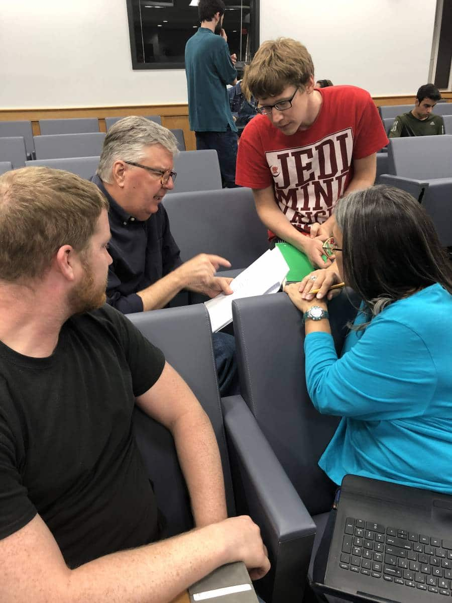 Master of Accounting student Matt Blockus and Dr. Gary McGill, associate Dean and Director of the Fisher School of Accounting, help Shelia Austin and Steven Rodgers with the financials for Red Boot Goat Farm's Business Plan in Business Plan Lab on April 4th.