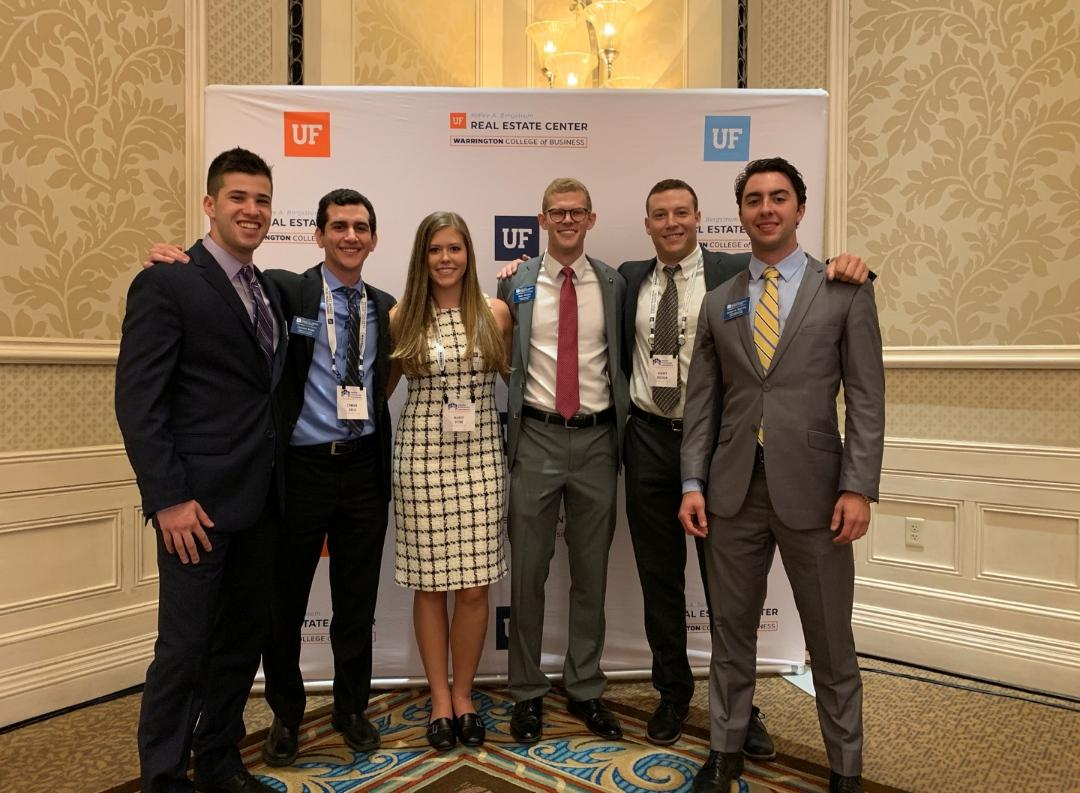 Mike Harris, fourth from left, with fellow MSRE students at the 2019 Trends Conference in Orlando, Florida.