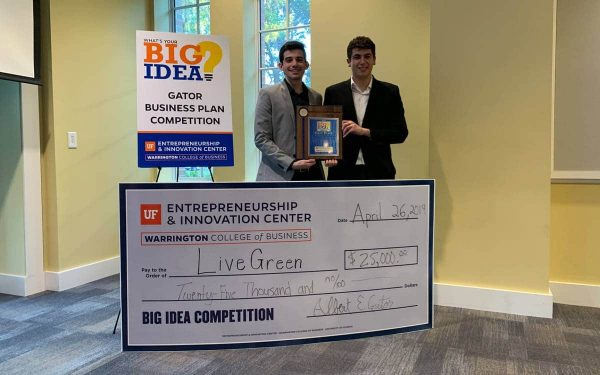 Pablo Garces and Brian De Souza with their first place $25,000 check at the Big Idea Competition.