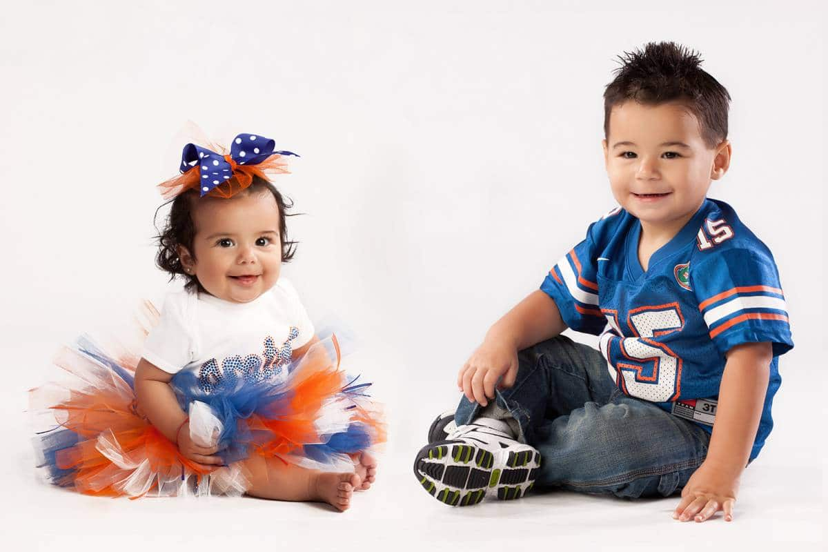 Gabriela and Tommy as young children dressed in Gator outfits.