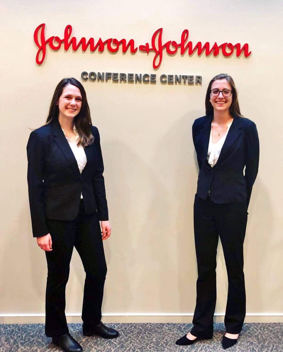 Heavener students stand in front of the Johnson & Johnson logo at their headquarters during the Johnson & Johnson Case Competition