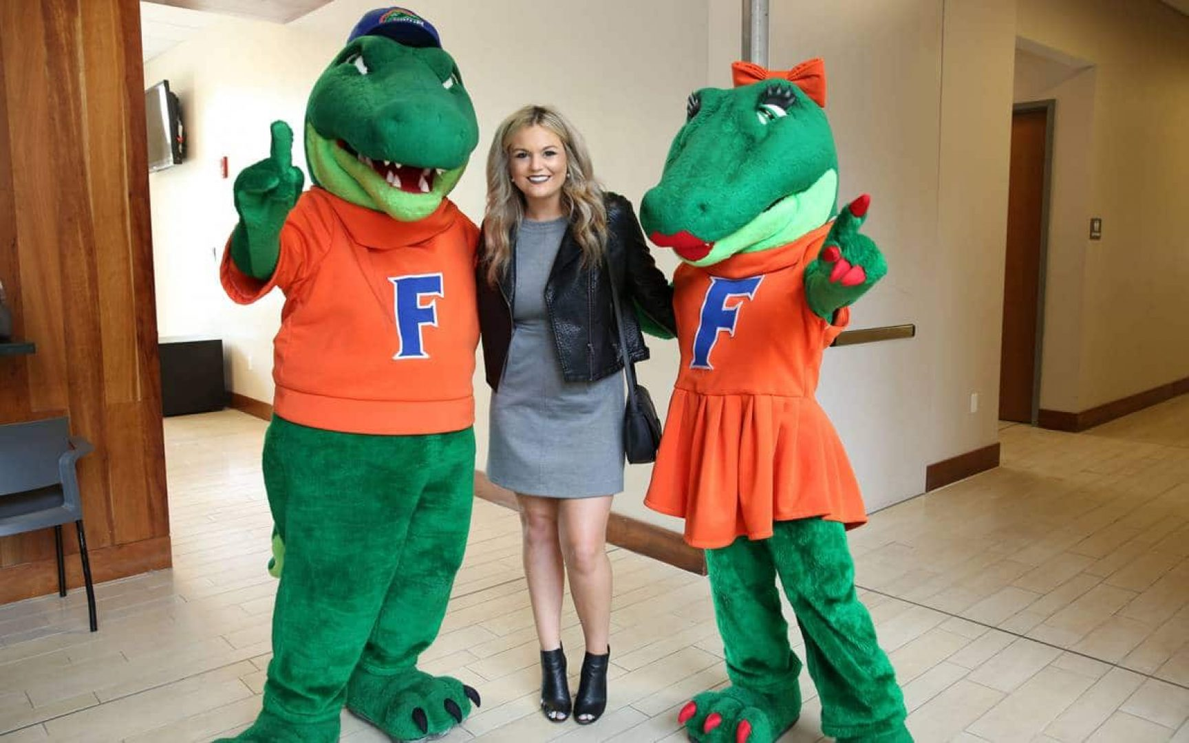 Emma Magee poses for a photo with Albert and Alberta