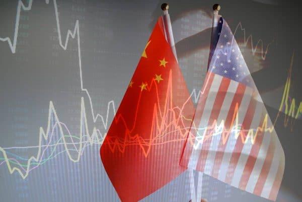 China and USA flag with grey background studio shot