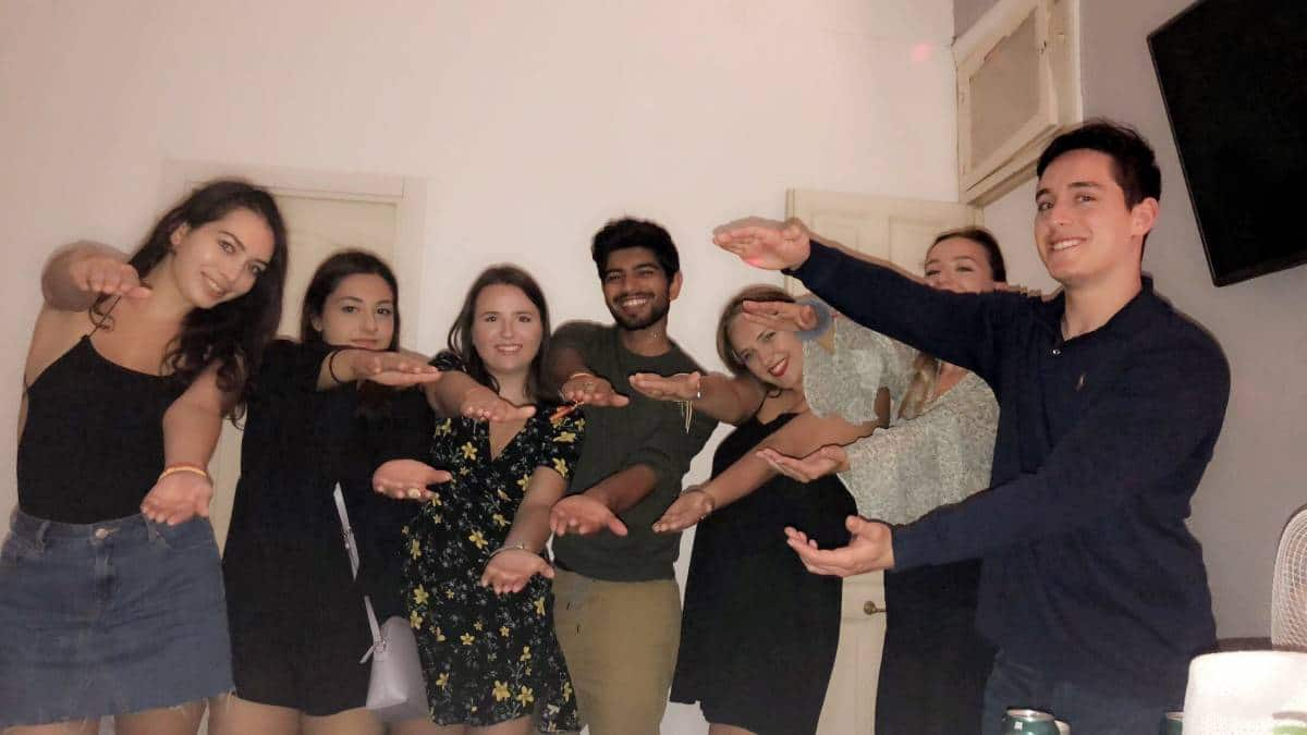 Seven students do the Gator Chomp