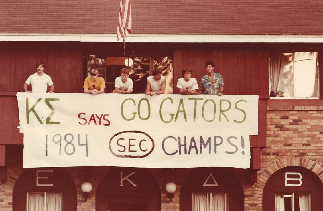 UF students from the 1980s holding banner saying Go Gators 1984 SEC Champs