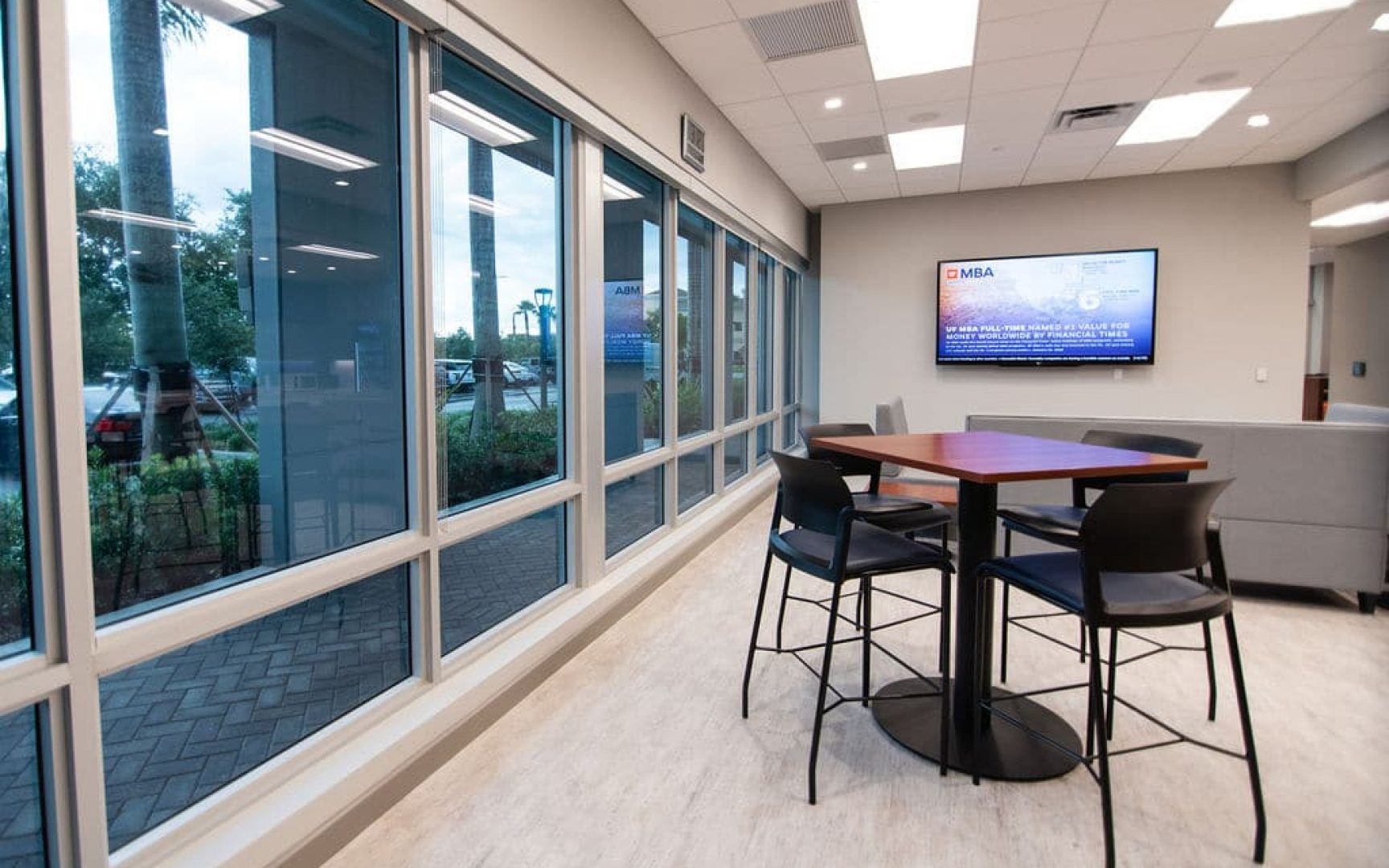 Lounge area with tables and couches for students in UF MBA South Florida Miramar location