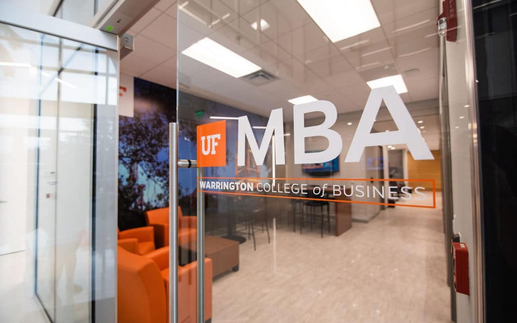 Glass door with UF MBA logo leading to the entrance of the new UF MBA South Florida location in Miramar