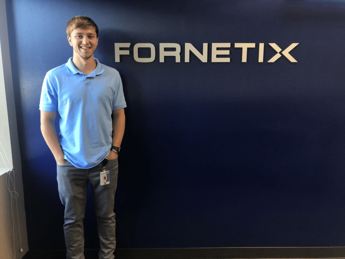 Matthew Bent stands in front of the Fornetix