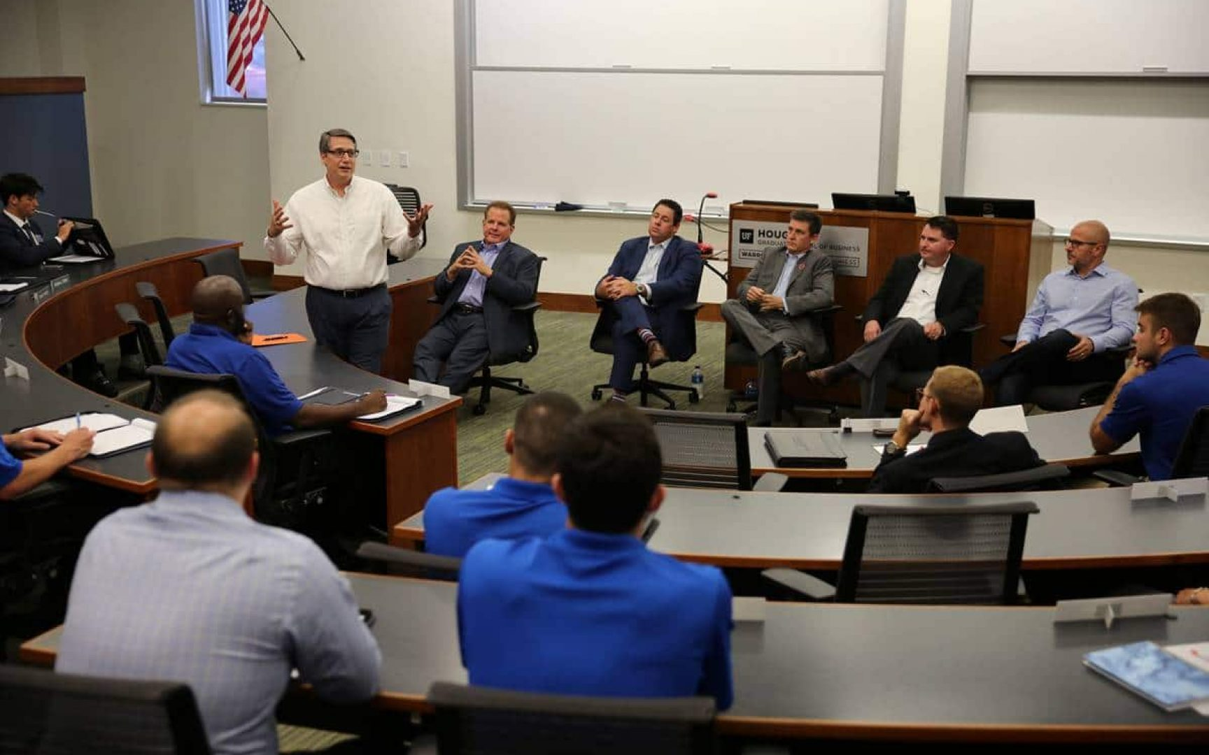 Students in audience listening to 6 seated members of the UF Real Estate Advisory Board