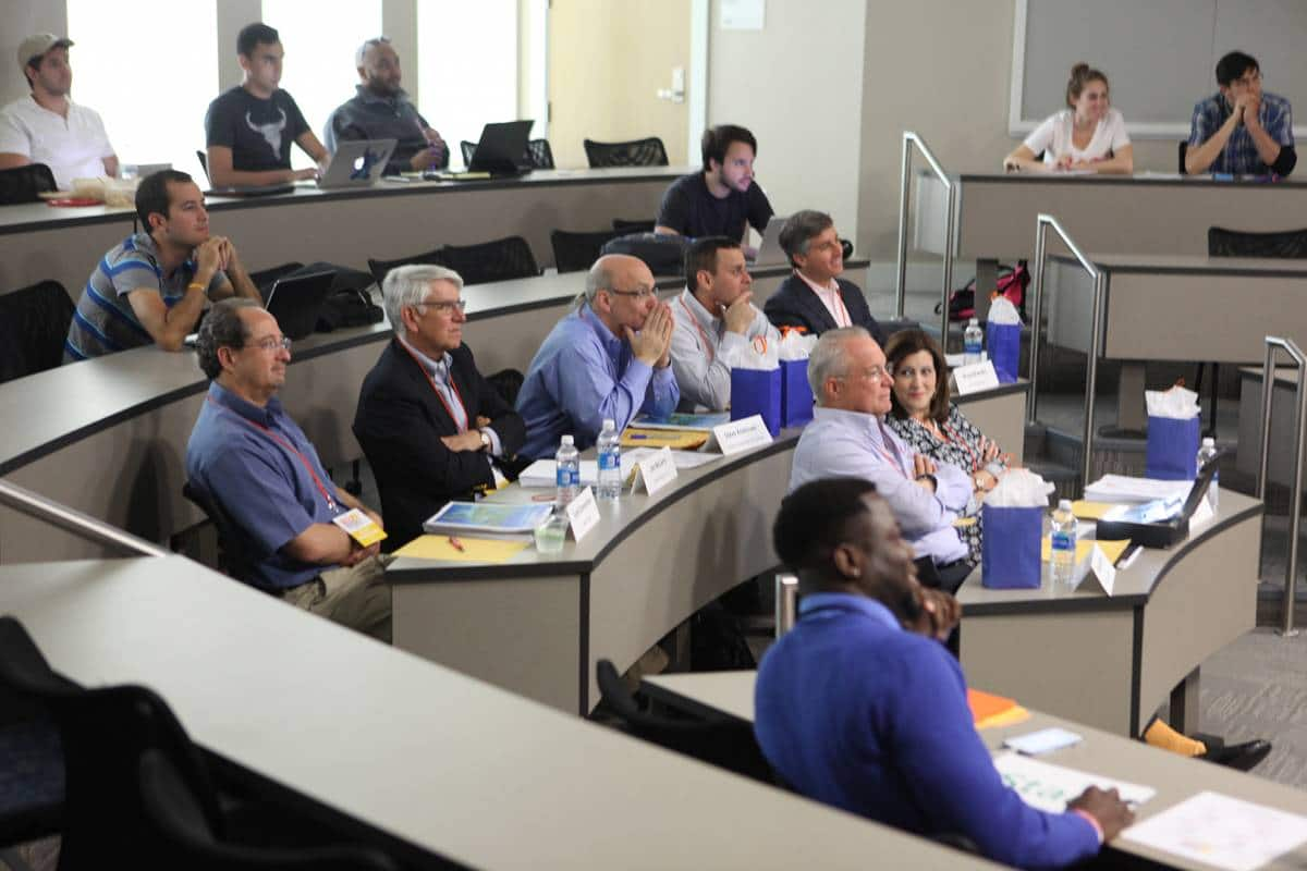 Bruce Brandes sits among the judges at the Big Idea Competition