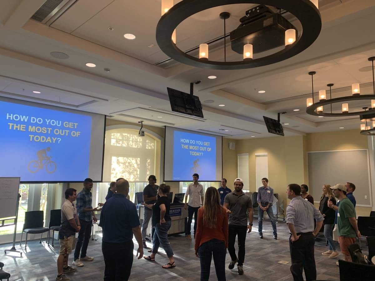 Group of UF MBA students walking around a large group during Transformation Weekend