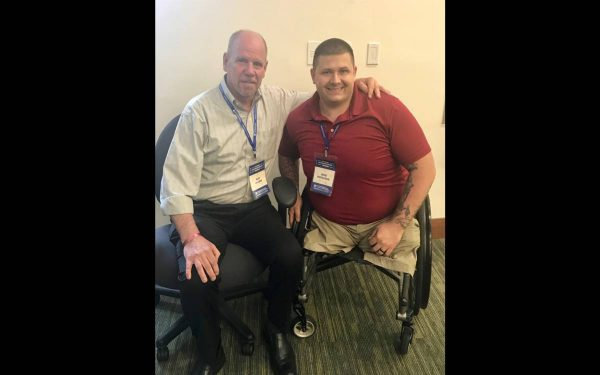 Art Jacobs with a VEP participant in a wheel chair