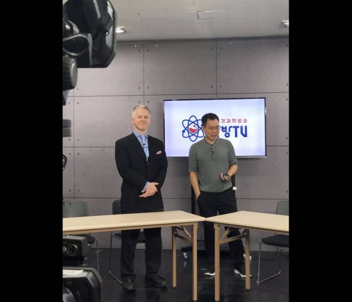 David Ross stands with AfreecaTV founder and CEO Kevin Seo on Kevin's live broadcast focused on science