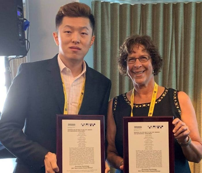 Yihao Liu and Joyce Bono hold their awards from Personnel Psychology