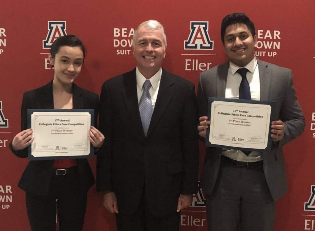 Jeanie Hoang, Brian Ray and Vikram Singh pose for a photo with their third place certificates