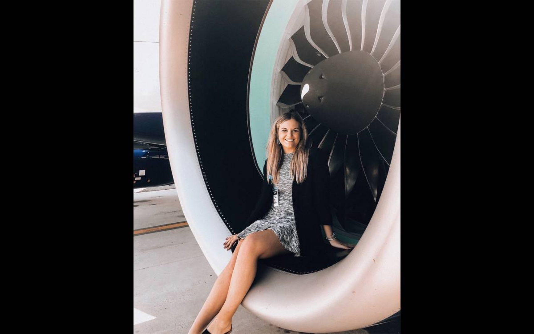 Emma Magee sits in the engine of an airplane