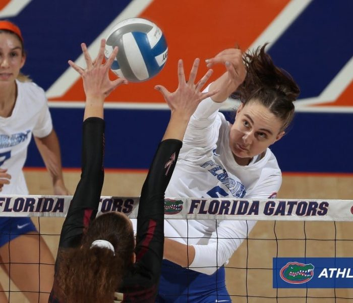 Rachael Kramer hitting a volleyball during a UF Volleyball match