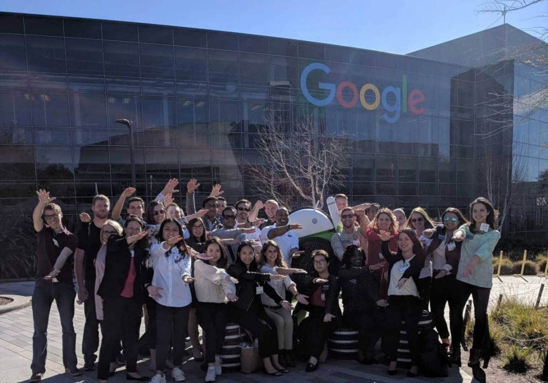 Large group of students do the Gator Chomp in front of Google