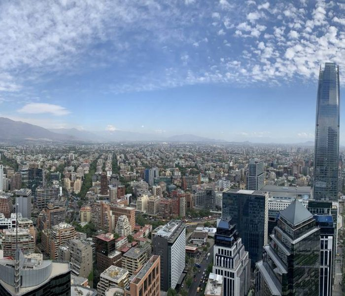 View of Santiago, Chile. Many buildings with mountains in the background.