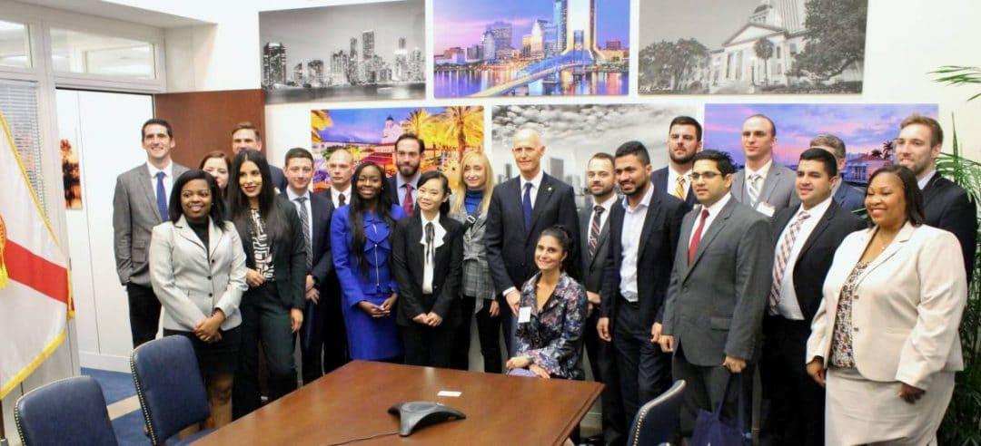 Group of UF MBA students with Senator Rick Scott