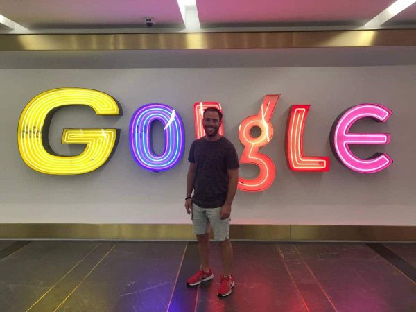 Henri Rojzman stands in front of the Google logo