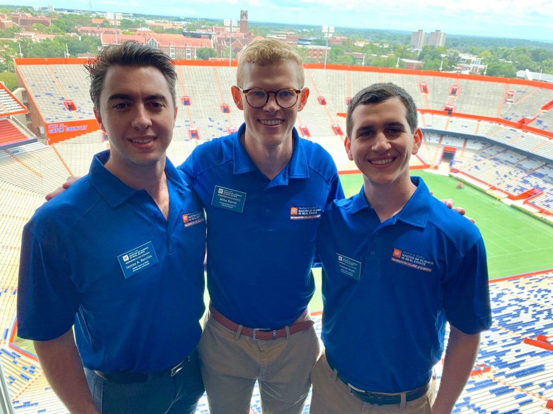 Connor Kreis, James Barrios and Mike Harris stand in Ben Hill Griffin Stadium