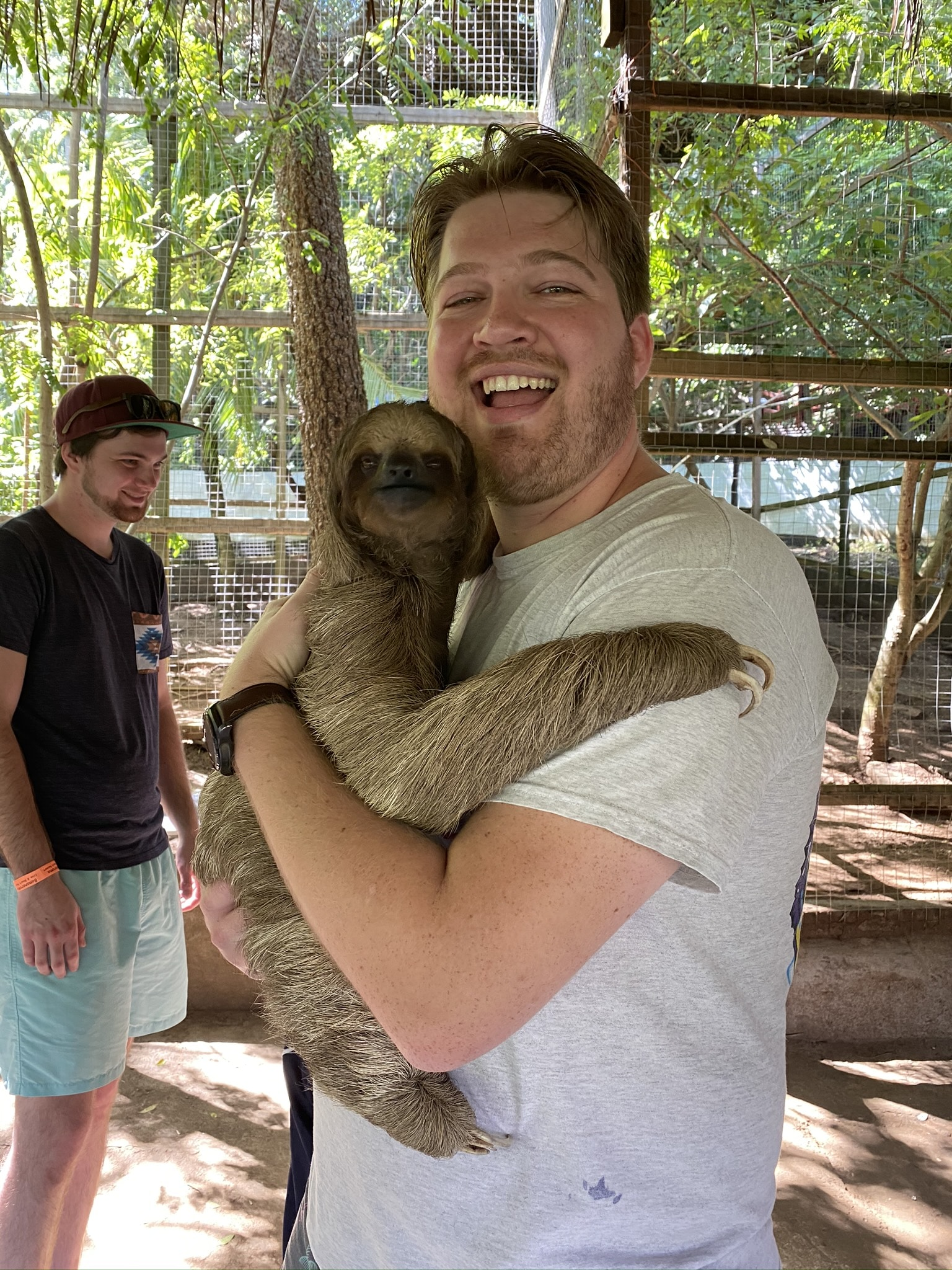 Michael Todd holding a sloth