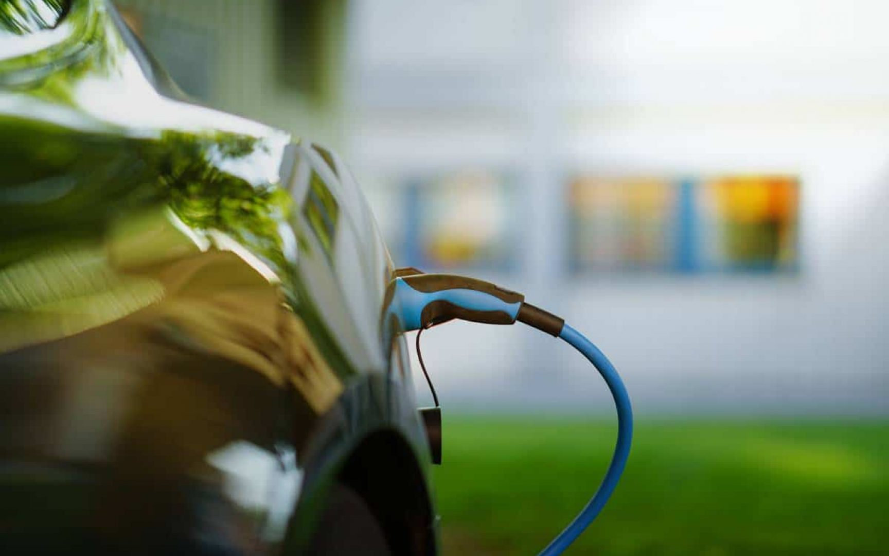 Side view of an electric car being charged