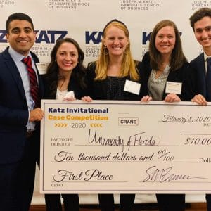 Four UF MBA students and their advisor hold their large $10,000 check from the Katz Case Competition
