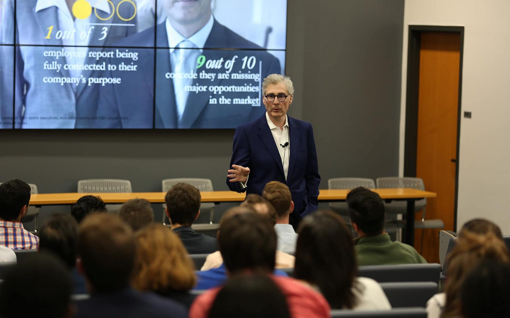 Cesare Mainardi speaks to a group of students in an auditorium