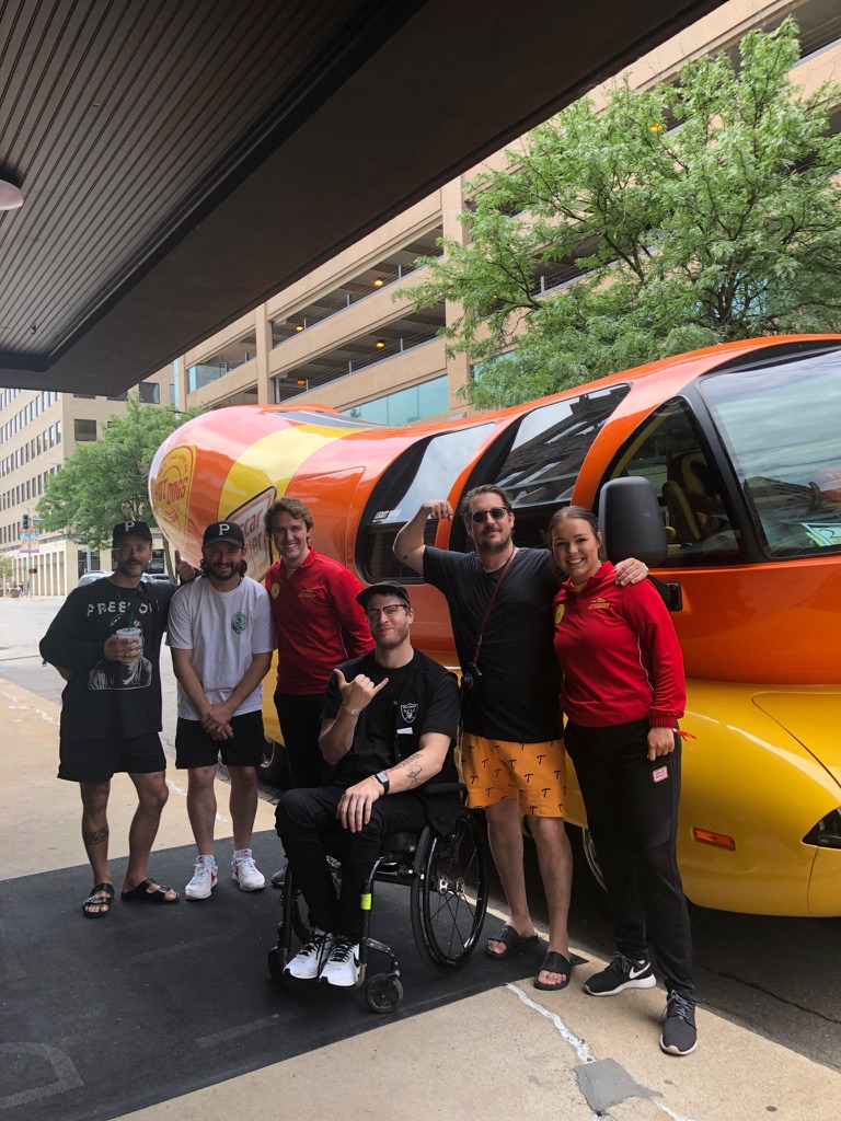 Tyler Peterson poses with four members of Portugal. The Man. and another Hotdogger