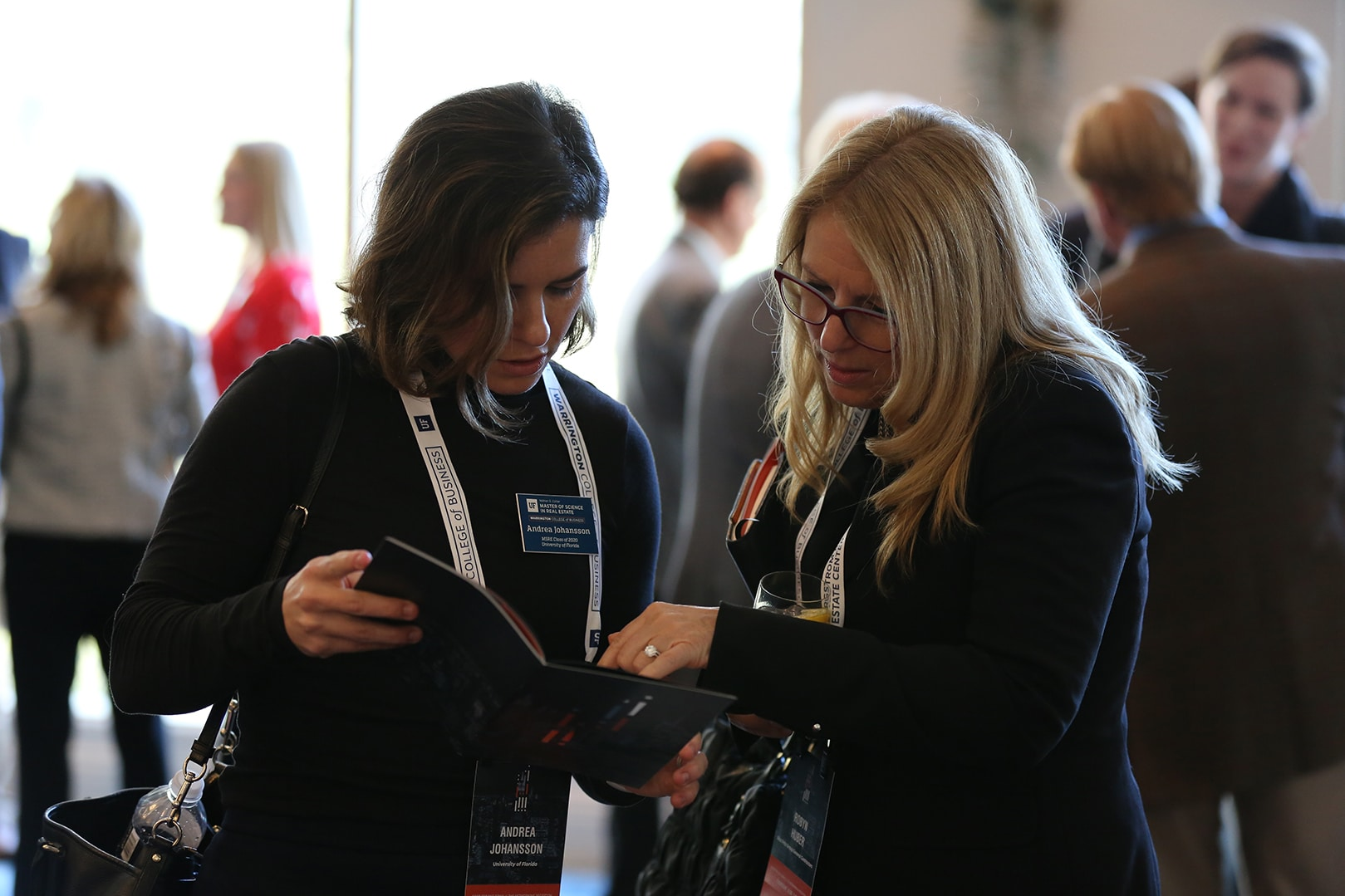 MSRE student Andrea Johansson looks at the Trends Conference program with Robyn Huber