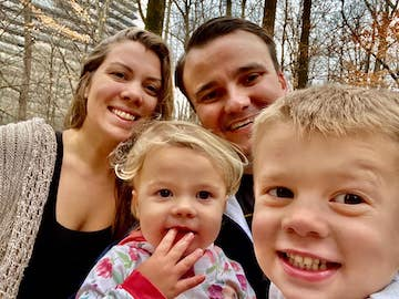 Emma and Brent Healy take a selfie with their two small children