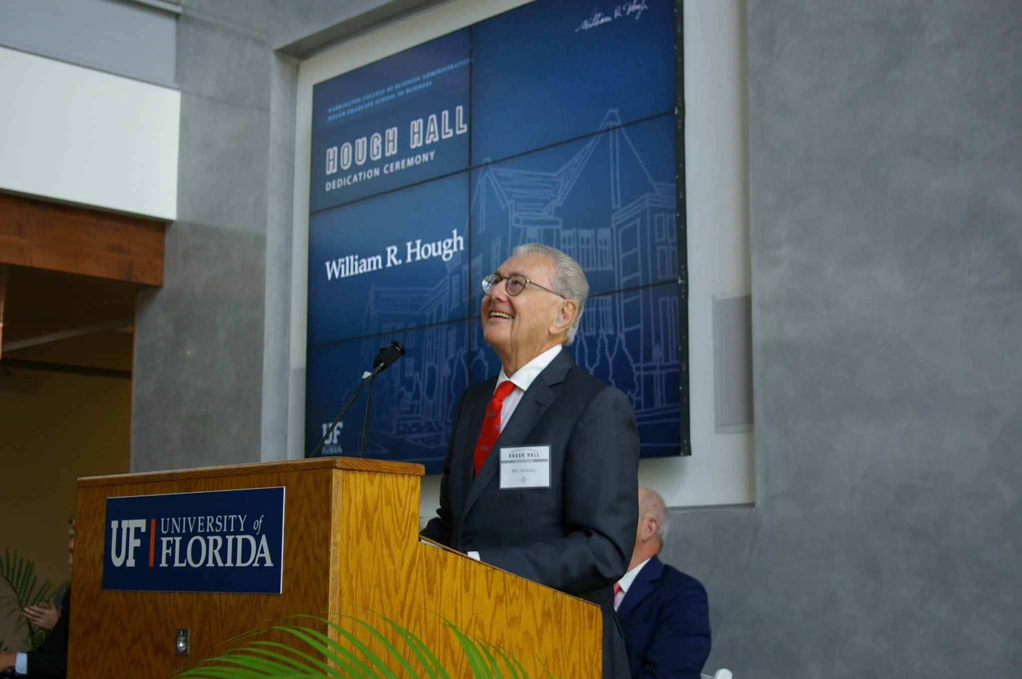 Bill Hough smiles while looking up at the crowd during the Hough Hall dedication ceremony.
