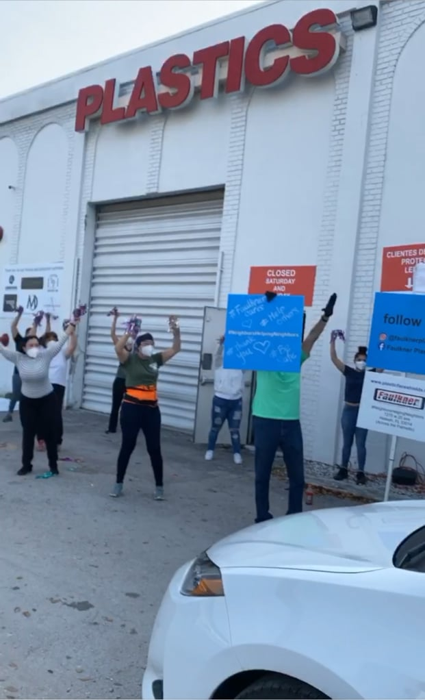 Faulkner Plastics employees cheering for medical workers at their face shield drive-thru
