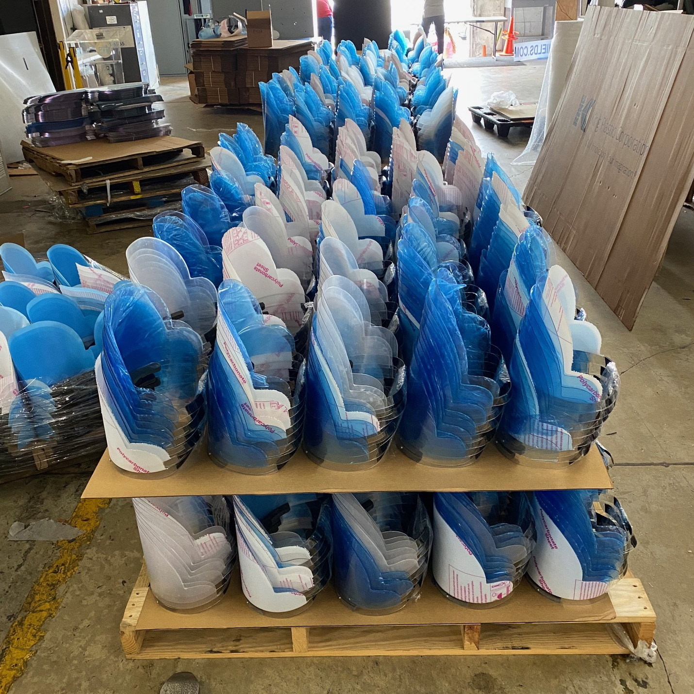 Stacks of plastic face shields made by Faulkner Plastics at their warehouse.