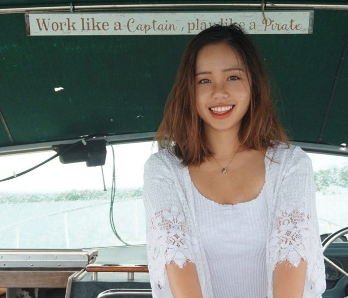 Xin Xin Liu stands on a boat