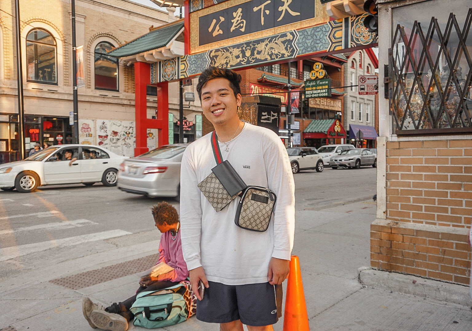 Andy Le stands in a busy city