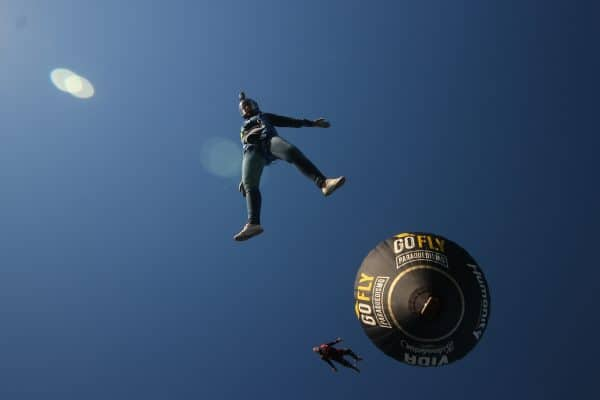 Emily Bombardi skydiving in Brazil with a balloon behind her