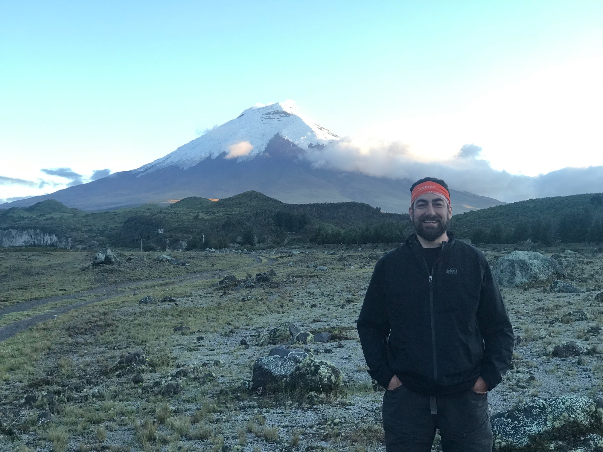 Nick Schumann poses for a photo in front of Cotopaxi