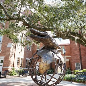 Gator Ubiquity Statue with Heavener Hall behind