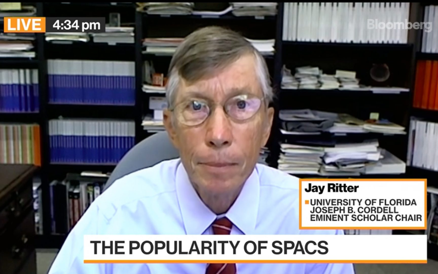 Jay Ritter speaks via Zoom. The lower-thirds line reads The popularity of SPACs.