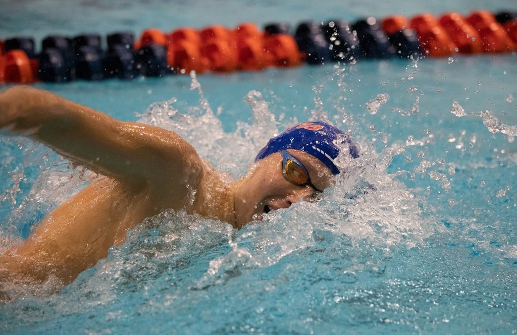 Side view of Matthew Anderson swimming in a pool.