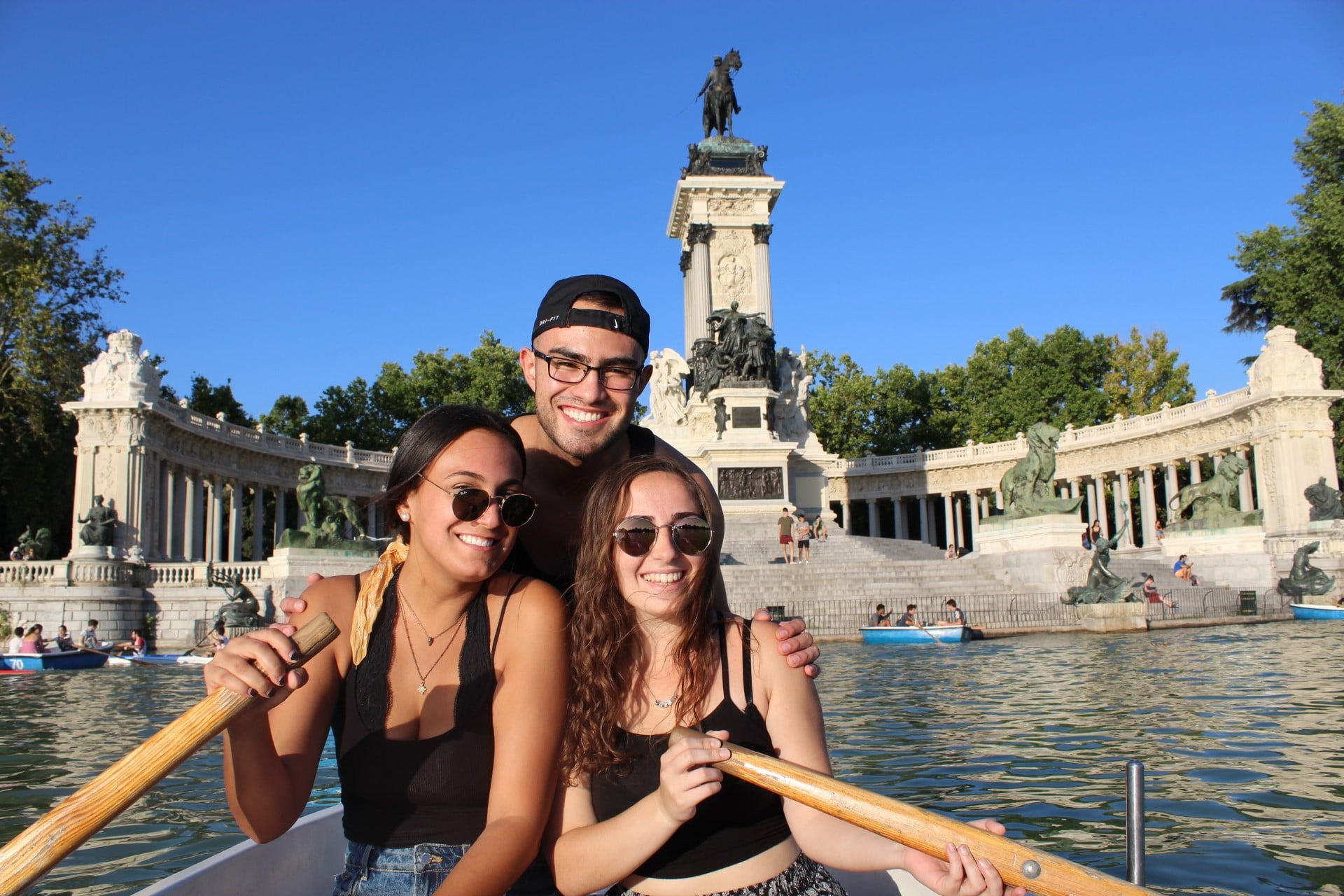 Iara Dircie with two other UF students canoeing in a lake in Madrid