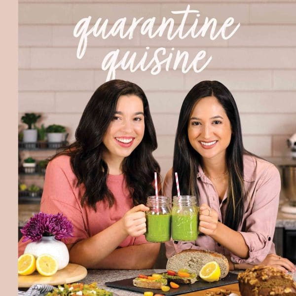 """Grave Ubben and Isabel Sanchez 'cheers' green smoothies with book title """"Quarantine Quisine"""" above."""