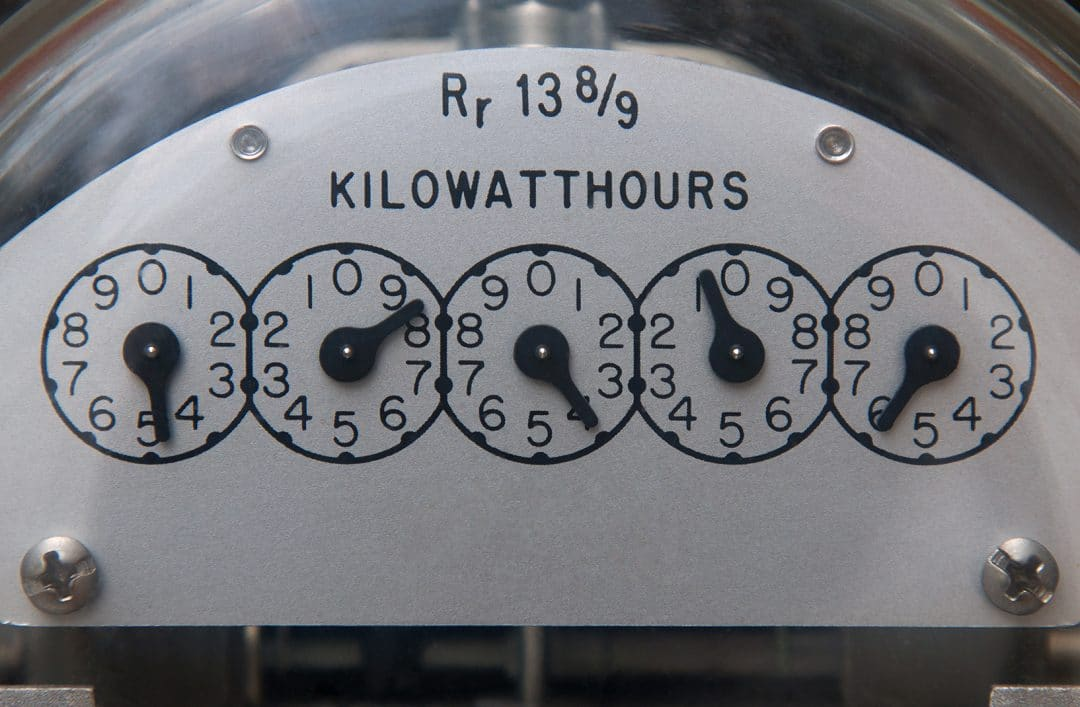 Close up image of an electric meter displaying the kilowatts per hour measurement.