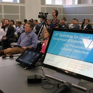 Large group of people listening to a presentation in the Business for Good Lab.