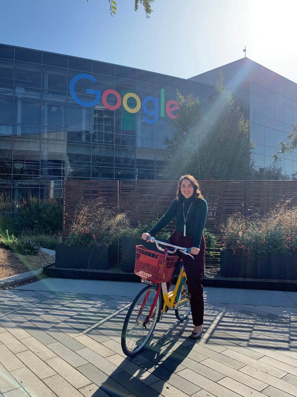Nelly Wilson sitting on a bike outside of Google's headquarters.