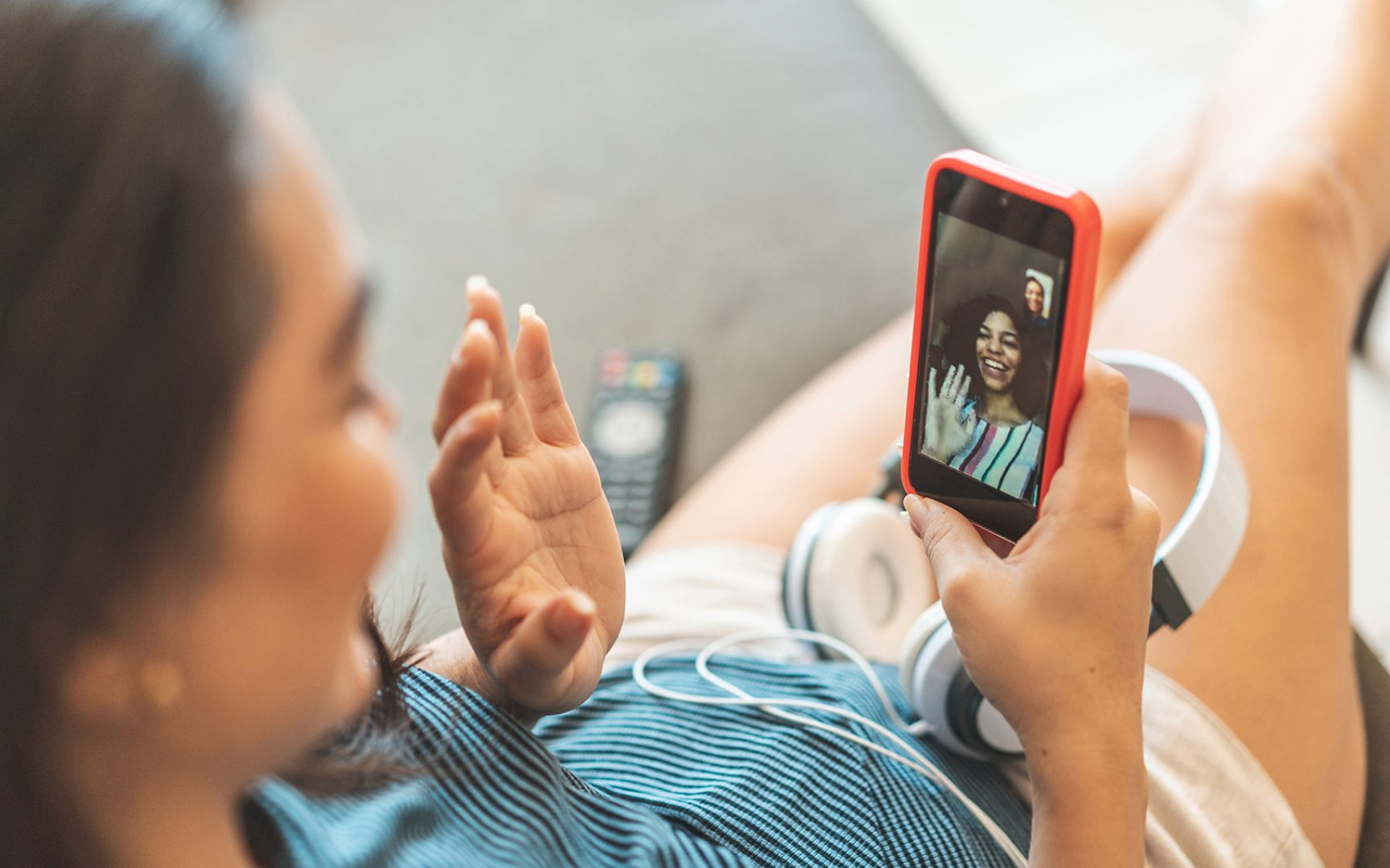 Two women on a video call at home